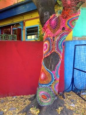 Crochet covers on tree trunks